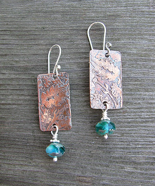 Teal glass with etched copper
