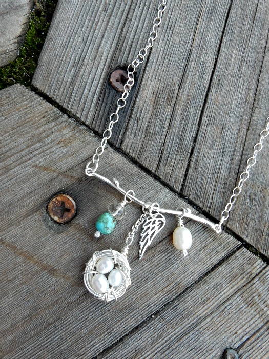 silver branch with charms